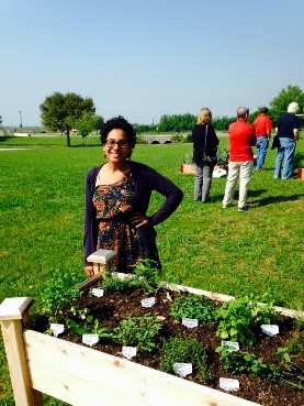 Valencia student poses with box garden